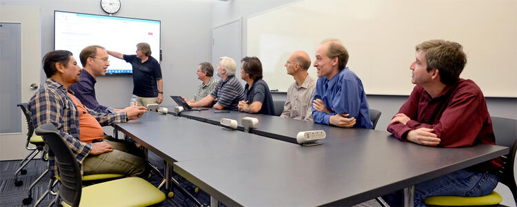 Meeting of 9 CSCF folk around a board-room table