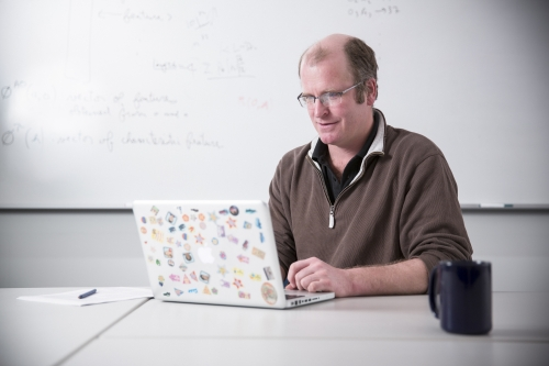 Professor Jesse Hoey on a laptop