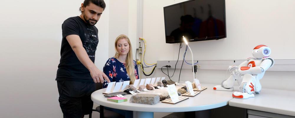 photo of Nalin Chhibber, Jessy Ceha and NAO, an educational robot