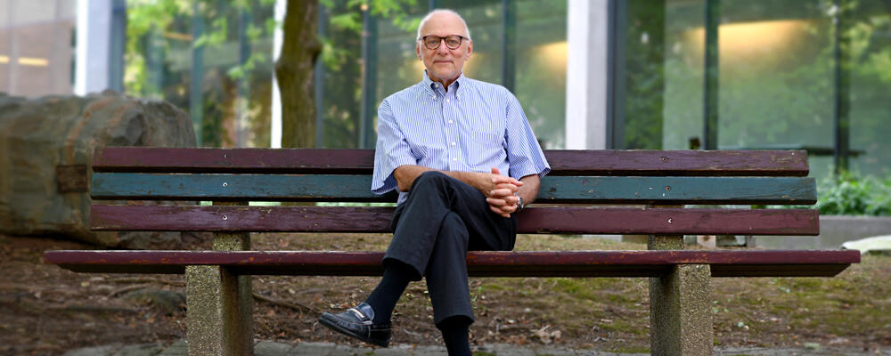 photo of  M. Tamer Özsu on bench at Waterloo's Peter Russel Rock Garden