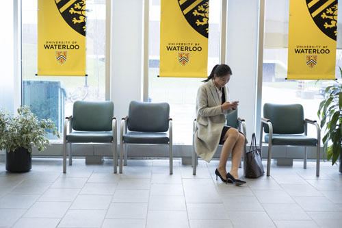 student preparing for an interview while sitting in a waiting room