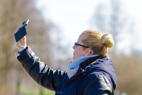 Stock image of woman taking a selfie