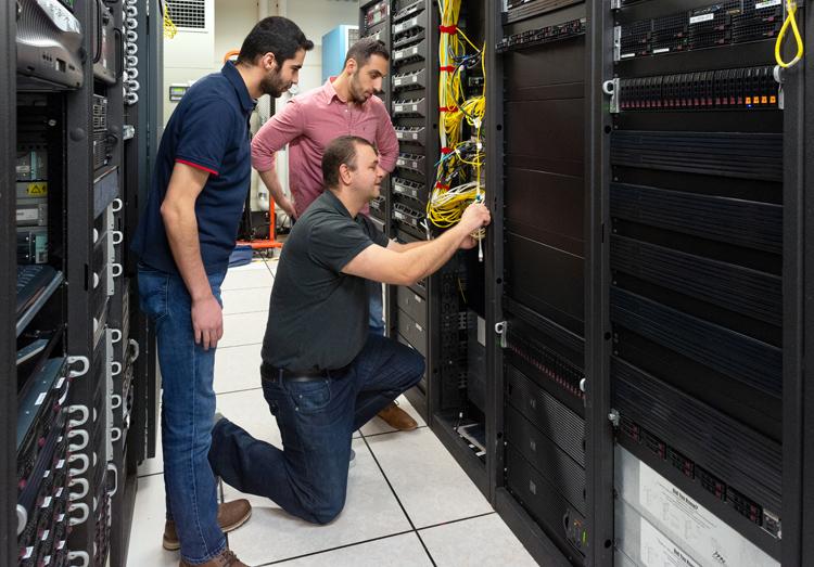 Ahmed Alquraan, Samer Al-Kiswany and Ibrahim Kettaneh in server room