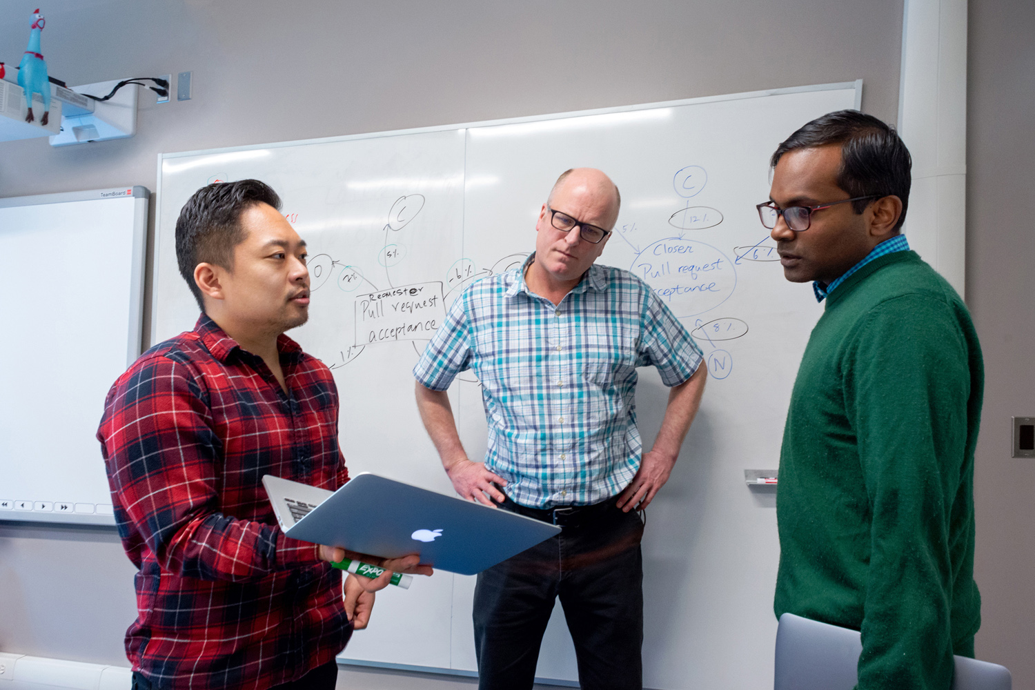 photo of Alex Yun and Professors Jesse Hoey and Meiyappan Nagappan