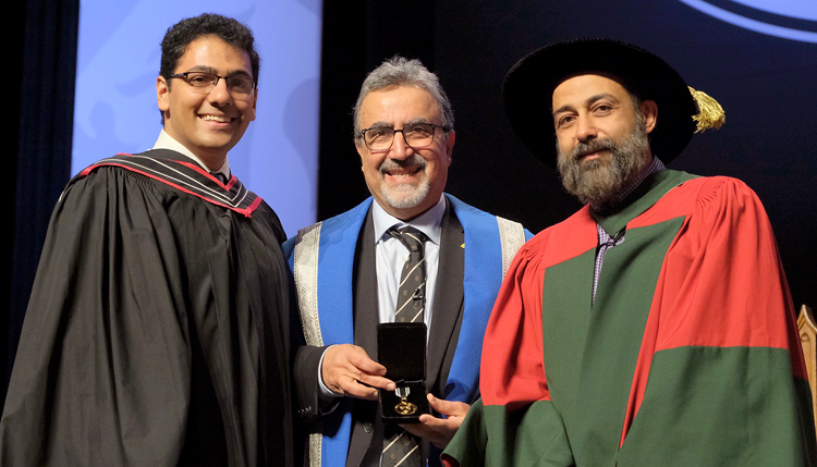 photo of Amir-Hossein Karimi, Waterloo President Feridun Hamdullahpur, Statistics and Actuarial Science Professor Ali Ghodsi