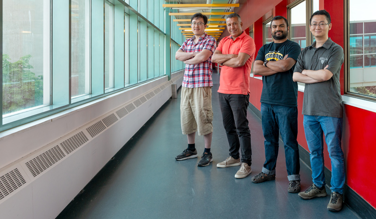 photo of Haibo Bian, Professor Raouf Boutaba, Shihabur Rahman Chowdhury and Tim Bai