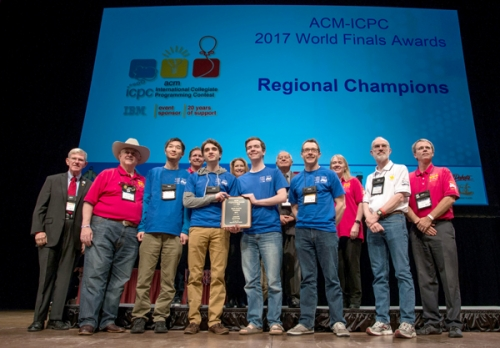 Waterloo ICPC regional champions on stage with prize