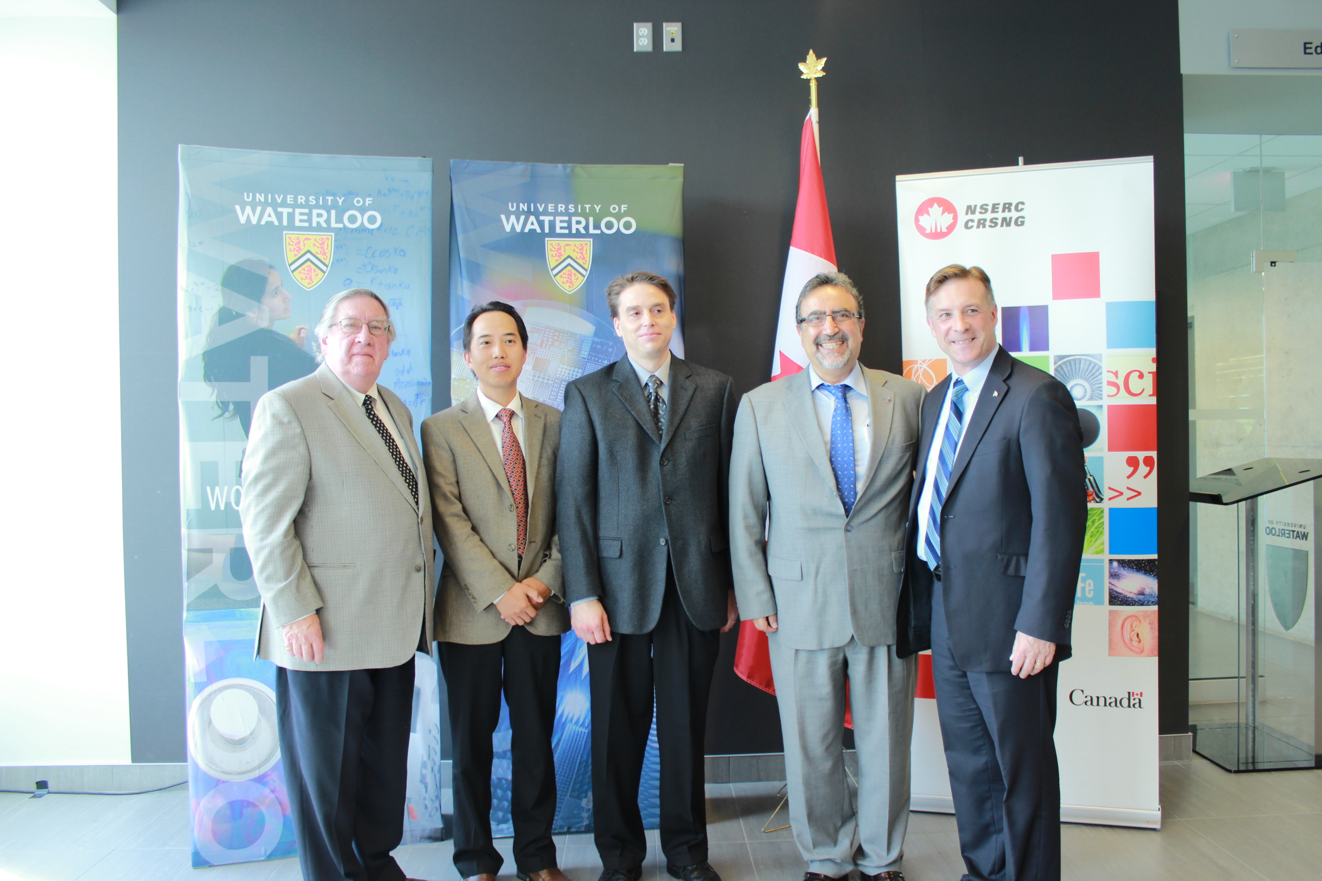 Zongwei Chen and John Watrous with Vice-President George Dixon, Kitchener-Waterloo MP Peter Braid, President Hamdullapur