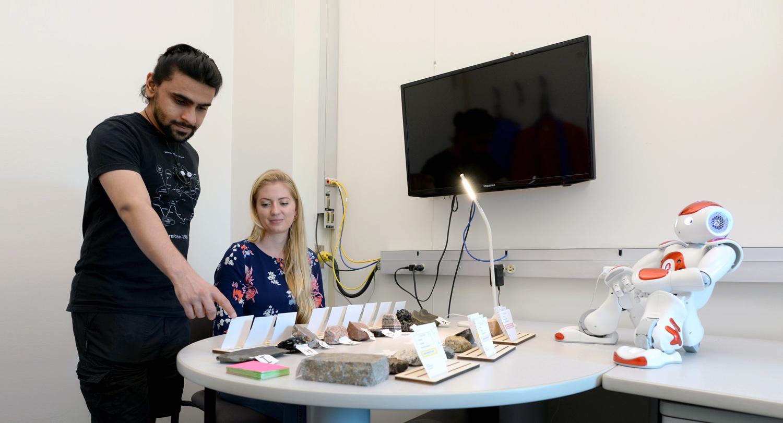 photo of Nalin Chhibber, Jessy Ceha and NAO, a humanoid educational robot
